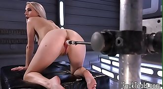 Busty blonde pussy toyed by faux-cock machine