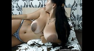 Chesty latina with big areolas teasing on cam