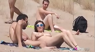 She fucks a dude in a beach full of voyeurs